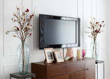 Large modern TV on a white wall in the interior of the room Royalty Free Stock Images