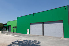 Large modern warehouse building. StorageLarge modern warehouse building green sheet stock photo