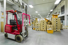 Large modern warehouse with forklifts.  Royalty Free Stock Images