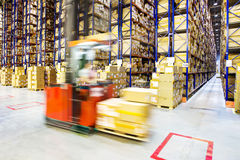 Large modern warehouse with forklifts Stock Image