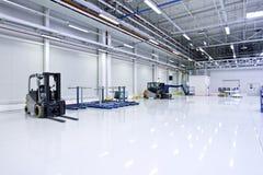Large modern Warehouse interior. Large bright Warehouse, forlift, modern Royalty Free Stock Photo