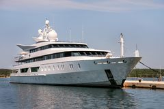 Large modern white yacht anchored in harbor. Large modern luxury white yacht and ship anchored in harbor. Large white modern motorboat super yacht and ship in Stock Images