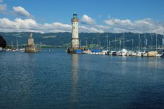 A large monument as entrance to the harbor of lindau on lake constance royalty free stock photo