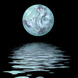 Large moon  on water. Large moon reflecting over smooth waves on water Royalty Free Stock Photo