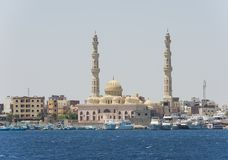 Large mosque in coastal egyptian city with boats Royalty Free Stock Photography
