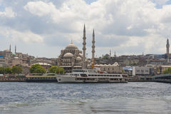 Large mosque next to river in city Stock Images