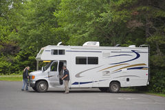 Large Motor Home with Tourists in the Woods Royalty Free Stock Photography