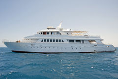 Large motor yacht at sea. A large private motor yacht out at sea Stock Image