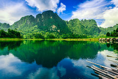Large mountain with blue sky and reflection from the water. Royalty Free Stock Image