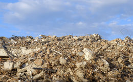 Large mountain demolition waste of building blocks and steel Stock Photo