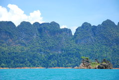 Large mountain in lake. This is a mountain in a large green lake in surat south of thailand Royalty Free Stock Photo