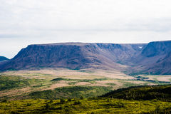 Large mountain plateau and valley under cloudy sky Stock Image