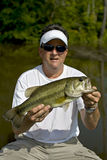 Large mouth bass. Man holding large mouth bass after catching it out of a river Stock Photos