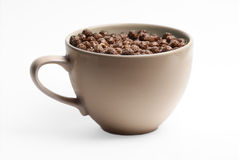 Large Mug of Chocolate Cereal. Large full of puffed chocolate breakfast cereal with milk Stock Images