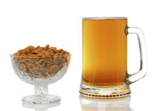 Large mug of light beer. tasty beverage in a pint of beer on a white background Royalty Free Stock Images
