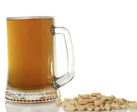 Large mug of light beer. tasty beverage in a pint of beer on a white background. salted peanuts Stock Photos