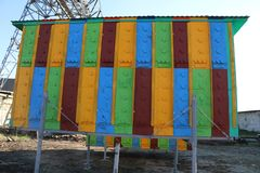 Large multi-colored mobile apiary for 48 hives. wooden house for bees. stock image