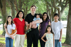 Large multiracial family of seven stock images