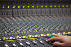 Large Music Mixer desk in recording studio. Closeup Stock Photos