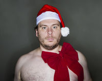 Large naked santa. Large naked man dressed in a santa hat ready for christmas Royalty Free Stock Images