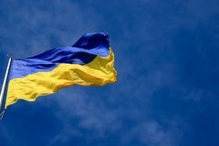 Large national flag of Ukraine in the blue sky. Big yellow blue Ukrainian state flag in the Dnepr city, Dnepropetrovsk. Large national flag of Ukraine flies in stock photography