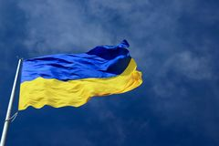 Large national flag of Ukraine in the blue sky. Big yellow blue Ukrainian state flag in Dnepr city, Dnepropetrovsk. Large national flag of Ukraine flies in the royalty free stock photos