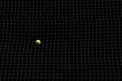 Large net with tennis ball obstacle challenge concept Stock Images
