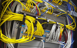 Large network hub and connected cables Stock Photography