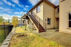 Large New luxury home exterior with balconies, three floors. Stock Photo