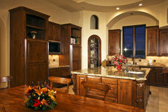 Large New Mansion Home Kitchen. A modern new home's fully equipped kitchen Royalty Free Stock Photography
