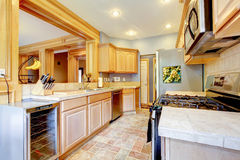 Large nice wood kitchen with grey and maple. Royalty Free Stock Images
