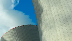 Large nuclear power plant. Closeup image of the cooling  towers of a large nuclear plant in Czech republic in Europe. Image taken on a sunny day with blue sky Stock Photography