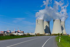 Large nuclear power plant. Image of a large nuclear plant with its big cooling towers in Czech republic in Europe. Image taken on a sunny day with blue sky Stock Photo