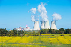 Large nuclear power plant. Image of a large nuclear plant with its big cooling towers in Czech republic in Europe. Image taken on a sunny day with blue sky Royalty Free Stock Photography