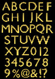 A large number of 3d Gold alphabet spelling art ar Royalty Free Stock Photography