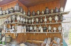 A large number of antique samovars on shelves stock images