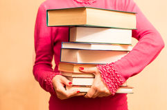 A large number of books in the hands Royalty Free Stock Photography