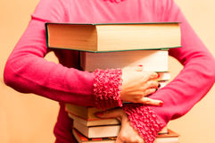 A large number of books in the hands of women Stock Images