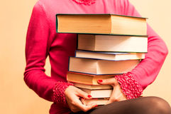 A large number of books in the hands of women Royalty Free Stock Photos