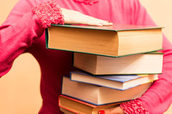 A large number of books in the hands Royalty Free Stock Photos