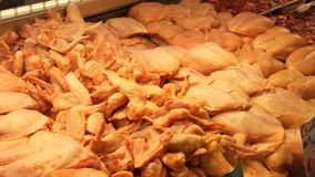 Large number of chicken giblets, entrails, wings, legs, stomachs, livers, hearts and other parts of the chicken carcass stock video
