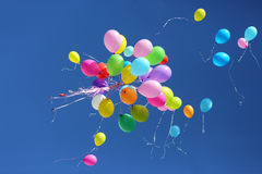 Large number of colorful balloons against the blue sky Royalty Free Stock Photography