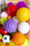 Large number of colorful plastic toy balls with different colors together in a basket royalty free stock photo
