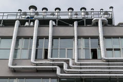 Large number of metal aluminum piping fixed to the facade of the building. Stock Images