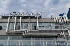 Large number of metal aluminum piping fixed to the facade of the building. Stock Photography