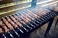 Large number of preparing kebabs on the grill Stock Photo