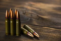Scattered cartridges for weapons. A large number of scattered cartridges of the popular caliber royalty free stock photo