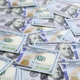 A large number of US dollar bills of a new design with a blue stripe in the middle. Top view.  stock image