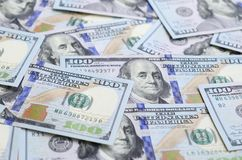 A large number of US dollar bills of a new design with a blue stripe in the middle. Top view.  royalty free stock photography