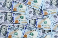 A large number of US dollar bills of a new design with a blue stripe in the middle. Top view.  stock images